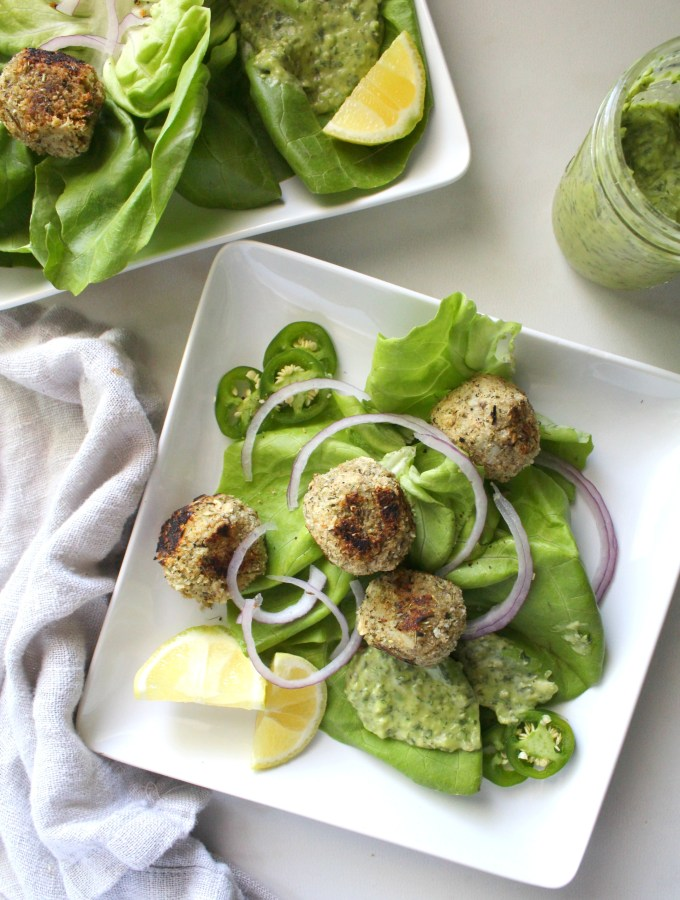 Salads got a whole lot tastier with this Vegan Meatball Salad with Creamy Dreamy Green Sauce. Packed full of butter lettuce, cauliflower meatballs, red onions, jalapeños and the BEST green dressing | ThisSavoryVegan.com #thissavoryvegan #mealprep #healthyrecipe