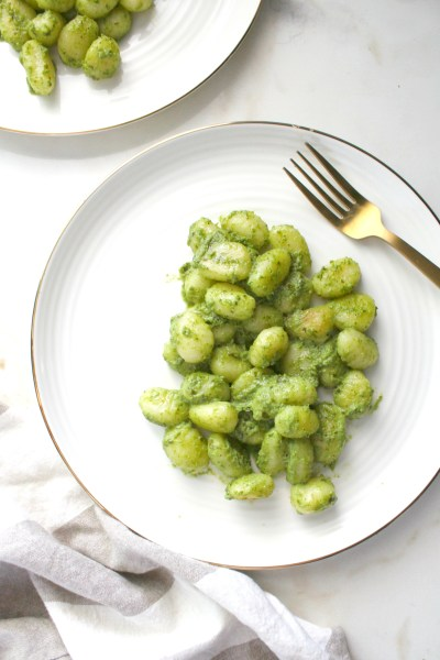 ThisPan Seared Vegan Pesto Gnocchi combines gnocchi that have been browned in vegan butter with fresh pesto for a quick weeknight dinner | ThisSavoryVegan.com #thissavoryvegan #veganpasta #pesto