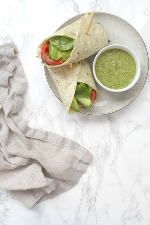 These Loaded Vegan Veggie Wraps with Chimichurri Dipping Sauce are the perfect on the go lunch. Packed with fresh veggies and served with an herb-filled sauce   ThisSavoryVegan.com #thissavoryvegan #backtoschool #veganlunch