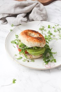 The Best Veggie Everything Bagel Sandwich - a toasted bagel is loaded up with vegan cream cheese, avocado and a whole lotta veggies. Perfect make ahead lunch | ThisSavoryVegan.com #thissavoryvegan #brunch #sandwich