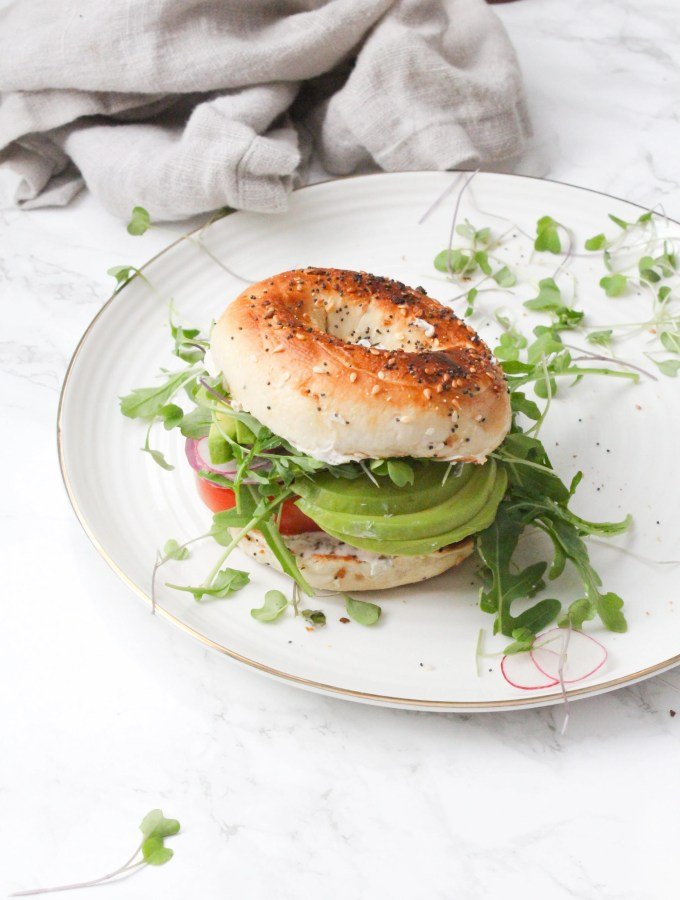 The Best Veggie Everything Bagel Sandwich - a toasted bagel is loaded up with vegan cream cheese, avocado and a whole lotta veggies. Perfect make ahead lunch   ThisSavoryVegan.com #thissavoryvegan #brunch #sandwich