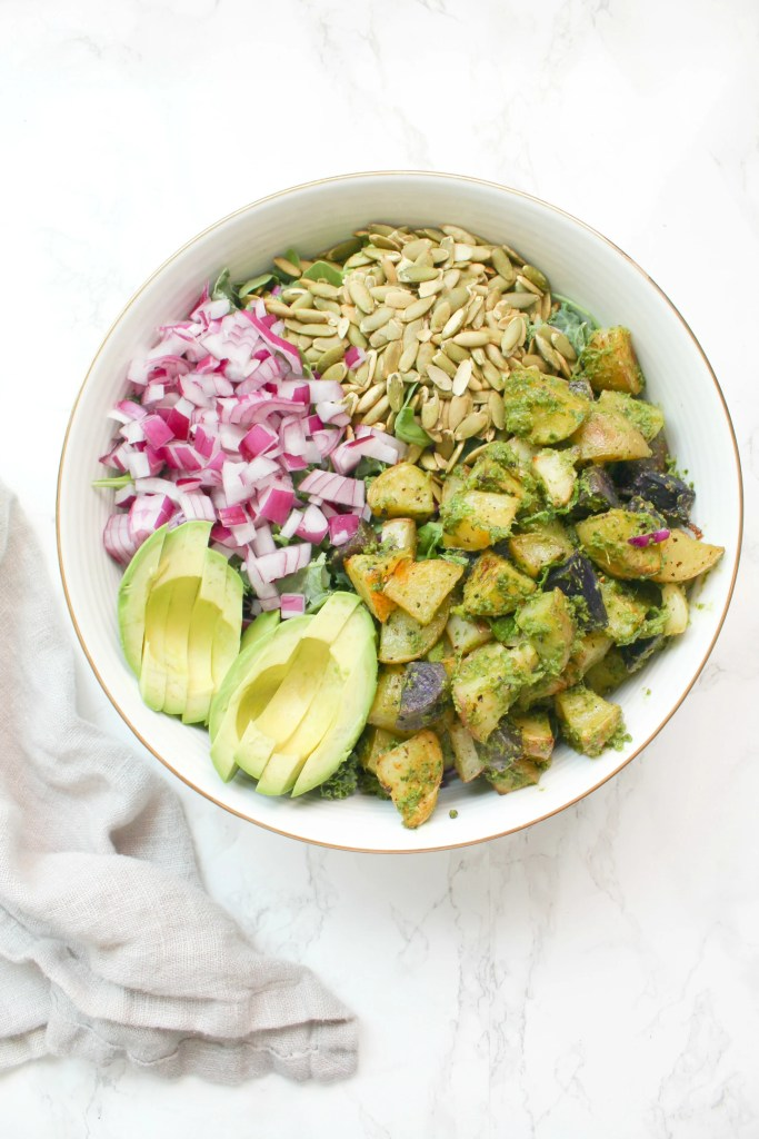 ThisGreen Goddess Detox Salad is packed with roasted pesto potatoes, delicious raw veggies and topped off with a lemon vinaigrette. The perfect salad when you want something healthy and delicious | ThisSavoryVegan.com #thissavoryvegan #detoxsalad #vegan