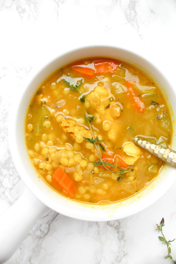 ThisVegan Chicken Couscous Soup is healthy, comforting and perfect for cold season. Next time you're feeling sick or it is a cold winter night, make this soup to feel warm and toasty | ThisSavoryVegan.com #thissavoryvegan #vegansoup #coldbuster