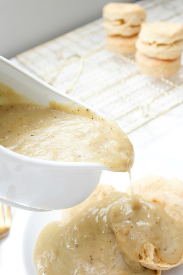 These Vegan Biscuits & Gravy are the ultimate comfort food. Buttery biscuits topped with the best vegan gravy and topped with fresh thyme | ThisSavoryVegan.com #thissavoryvegan #veganbrunch