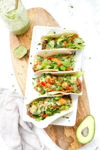 These Crispy Vegan Potato Tacos with Jalapeño Cilantro Sauce are filled with beans, crispy potatoes, crunchy lettuce and the best sauce | ThisSavoryVegan.com #thissavoryvegan #vegantacos #tacotuesday