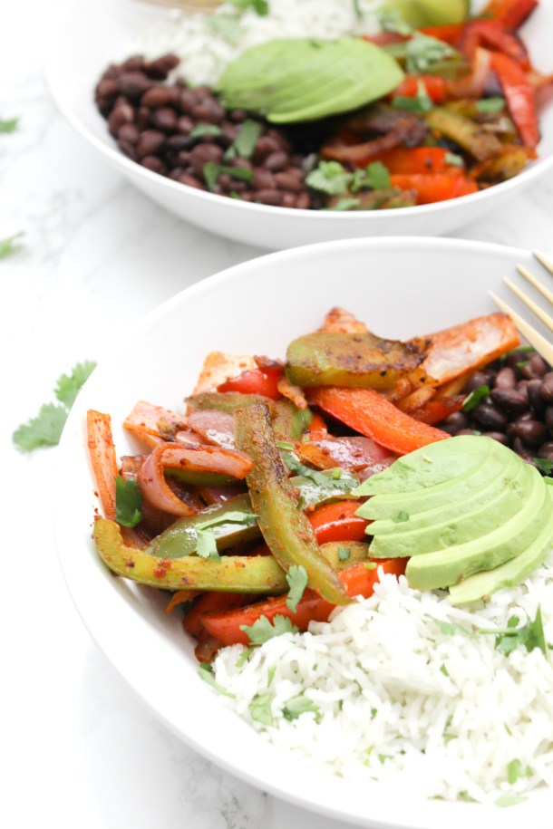These Fajita Veggie Bowls with Cilantro Lime Rice are a tastier version of Chipotle that you can make at home in 30 minutes!   ThisSavoryVegan.com #thissavoryvegan #buddhabowl