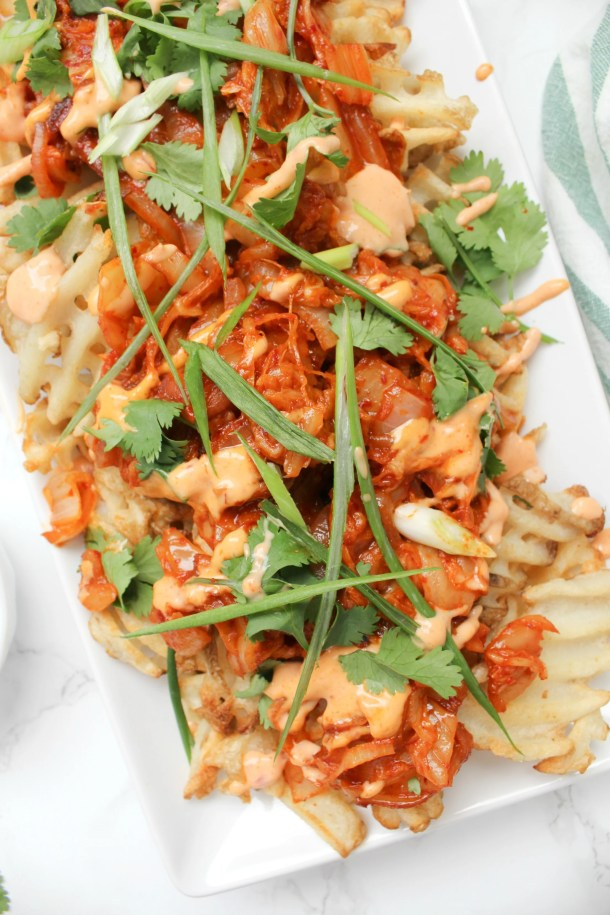 Loaded Vegan Kimchi Fries - crispy fries, sriracha mayo and zesty kimchi all topped off with tons of fresh cilantro and green onions   ThisSavoryVegan.com #thissavoryvegan #loadedfries