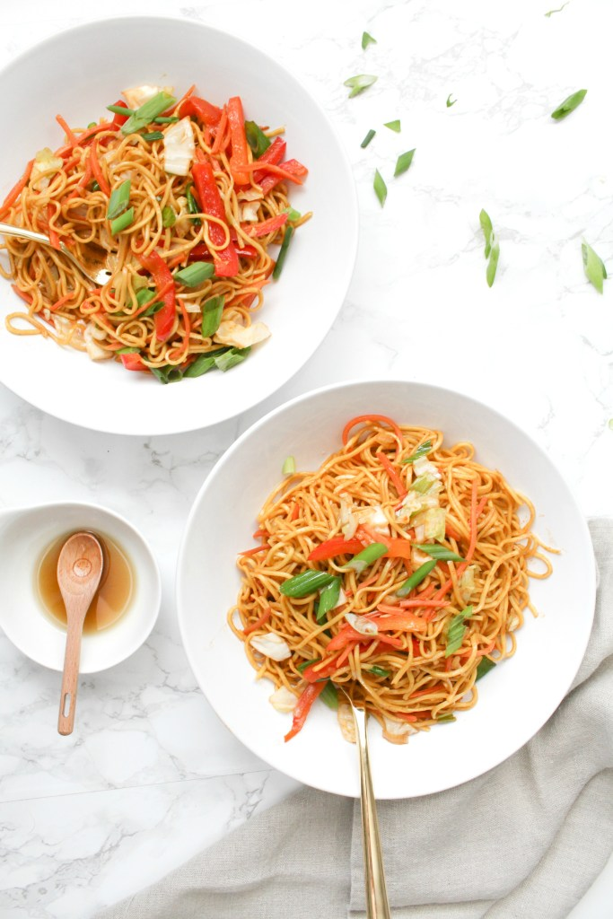 This 20 Minute Veggie Stir-Fry is the perfect quick dinner. Loaded up with tons of veggies, noodles and a simple stir-fry sauce | ThisSavoryVegan.com #thissavoryvegan #vegan #quickdinner