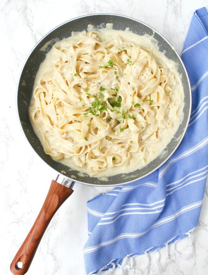 This Vegan Fettuccine Alfredo with Truffle Oil is the ultimate comfort meal. A creamy white wine sauce is combined with fettuccine noodles then topped with truffle oil | ThisSavoryVegan.com #thissavoryvegan #vegan #veganalfredo