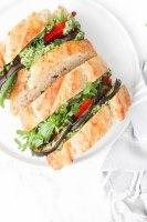 These Roasted Eggplant Sandwiches with Vegan Arugula Walnut Pesto are packed with roasted red peppers, eggplant, fresh arugula and pesto mayo | ThisSavoryVegan.com #thissavoryvegan #vegan #vegansandwich