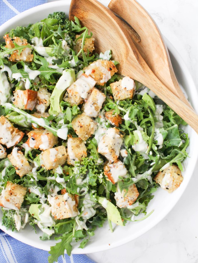This Vegan Avocado Kale Caesar with Everything Bagel Croutons is going to be your go-to salad. Homemade croutons and the BEST tahini dressing   ThisSavoryVegan.com #thissavoryvegan #vegan #vegancaesar