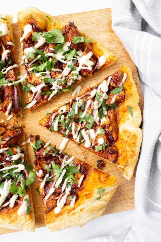 This Vegan BBQ Chicken Pizza is made extra crispy and delicious by using a cast iron skillet. Top it off with vegan ranch and fresh cilantro!   ThisSavoryVegan.com #thissavoryvegan #vegan #veganpizza