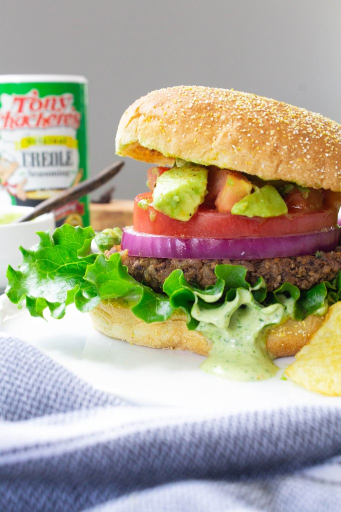 These Vegan Cajun Black Bean Burgers are loaded with a zesty patty, cajun aioli and an avocado salsa. The ultimate combo of flavors | ThisSavoryVegan.com #thissavoryvegan #veganburger #summereats