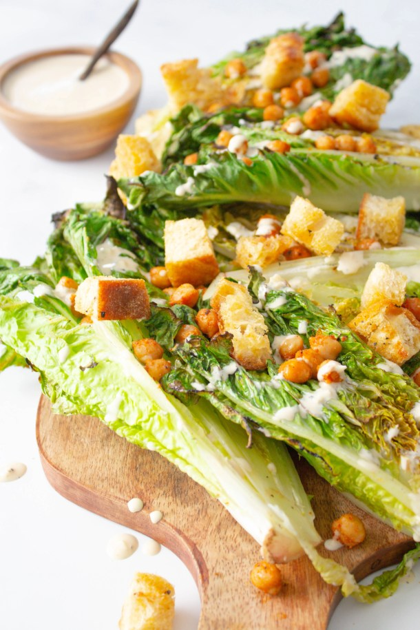 This Vegan Grilled Caesar Salad is the perfect summer salad - romaine is given a quick char then topped off with roasted chickpeas, homemade croutons and tahini caesar dressing | ThisSavoryVegan.com #thissavoryvegan #vegan #vegancaesarsalad