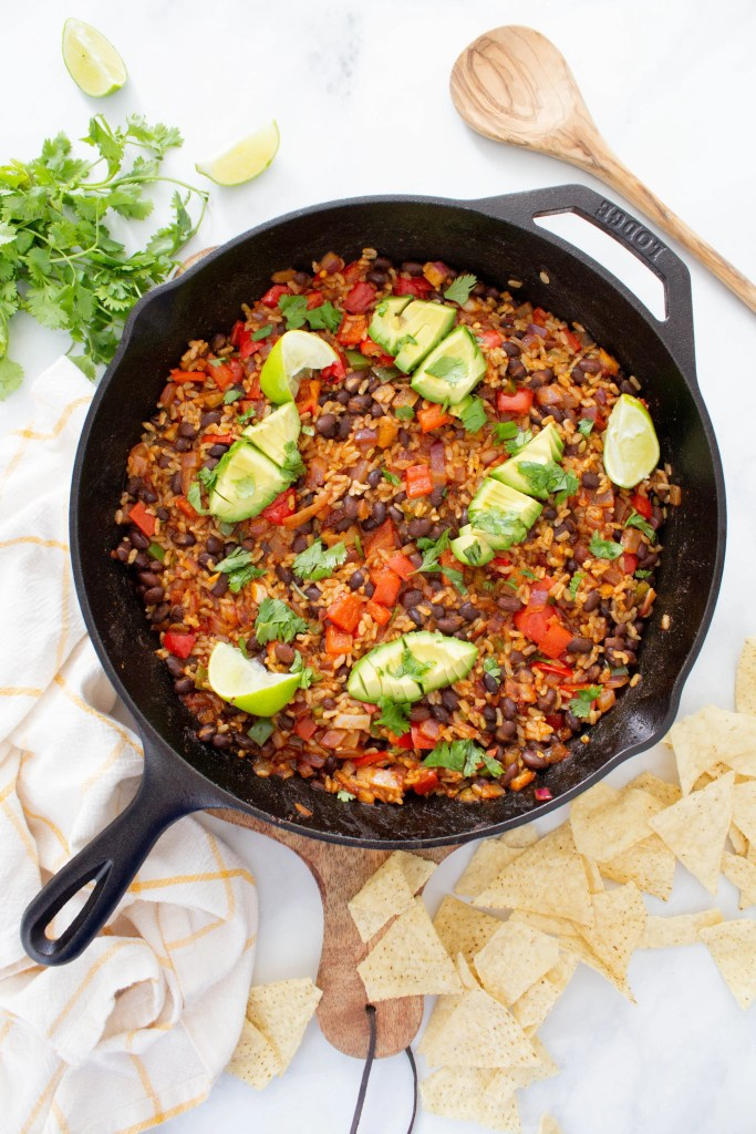 This Black Bean Brown Rice Vegan Taco Skillet is a super easy dinner or make ahead lunch - serve in a bowl, over a salad or in taco shells   ThisSavoryVegan.com #thissavoryvegan #vegan #veganskillet