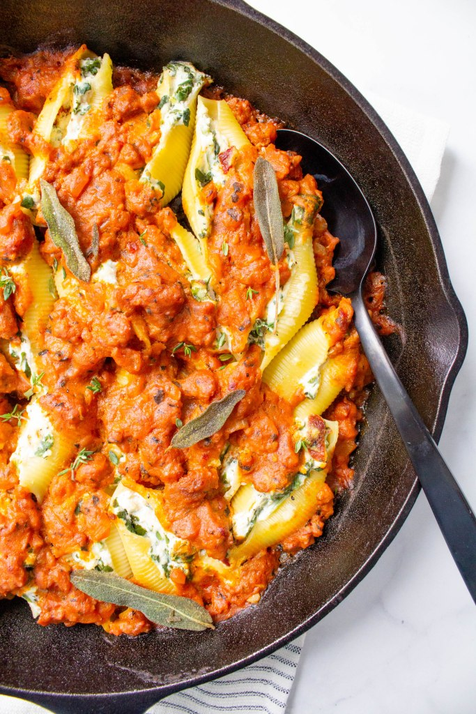 These Vegan Pumpkin and Sausage Stuffed Shells are filled with tofu ricotta and topped with fried sage. A simple and delicious vegan dinner! | ThisSavoryVegan.com #thissavoryvegan #vegan #veganpasta