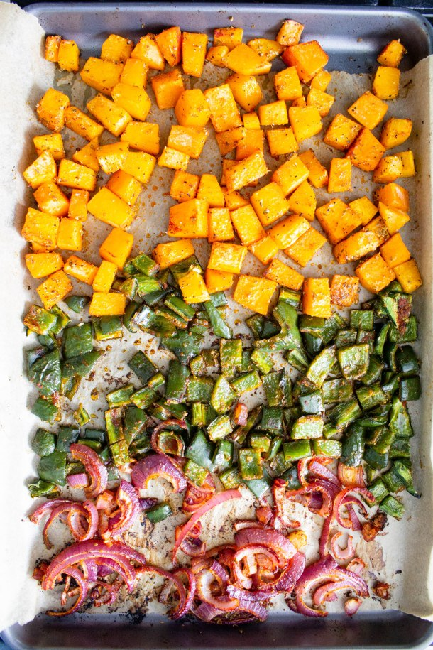 This Vegan Butternut Squash Poblano Enchilada Casserole is creamy, savory and filled with black beans and roasted veggies. Perfect weeknight dinner | ThisSavoryVegan.com #thissavoryvegan #veganenchiladas