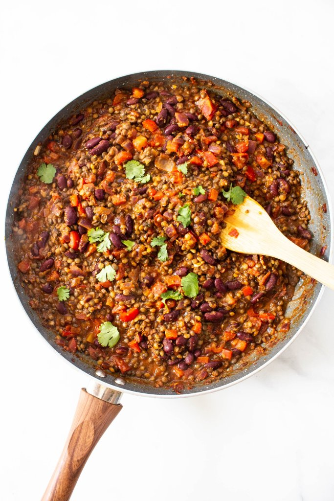 These Zesty Lentil, Bean & Rice Plates are a super easy 30 minute vegan dinner. Filled with veggies, beans, lentils and a savory sauce | ThisSavoryVegan.com #thissavoryvegan #veganskillet #vegan