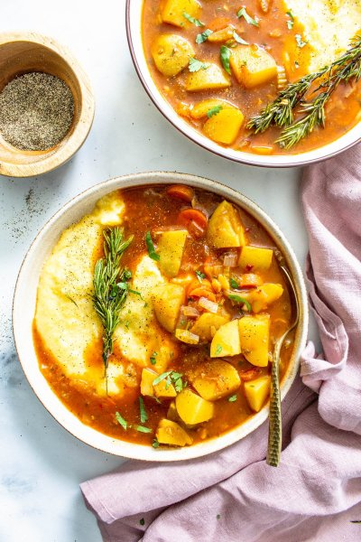 This Vegan Potato Stew with Rosemary Garlic Polenta is a simple dinner that packs tons of flavors and veggies into one easy to make meal | ThisSavoryVegan.com #thissavoryvegan #veganstew #veganpolenta