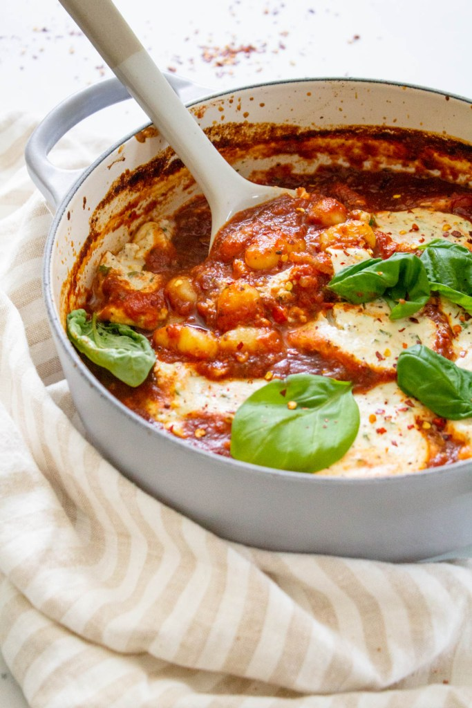 This Baked Gnocchi with Vegan Tofu Ricotta is a saucy casserole that is best served with rosemary garlic bread and a big green salad on the side | ThisSavoryVegan.com #thissavoryvegan #vegancasserole #gnocchi
