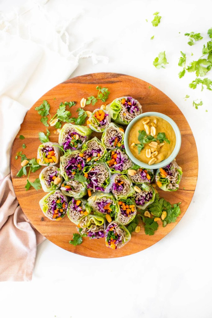 These Soba Noodle Summer Rolls with Peanut Sauce are the perfect no-cook meal. Fresh veggies, fiber-packed soba noodles and a creamy peanut sauce. A great vegan lunch or dinner | ThisSavoryVegan.com #thissavoryvegan #summerroles #peanutsauce