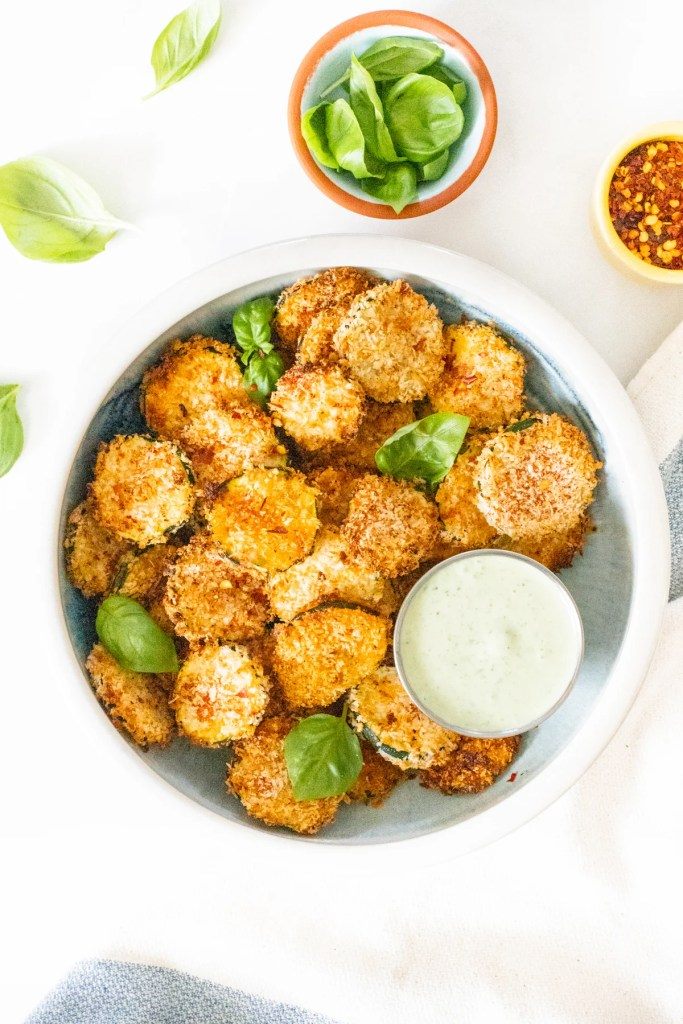 These Air Fryer Zucchini Chips with Vegan Basil Aioli are the best snack idea! They are crispy, flavor-packed and a healthier version of chips | ThisSavoryVegan.com #thissavoryvegan #airfryerrecipe #zucchinirecipes