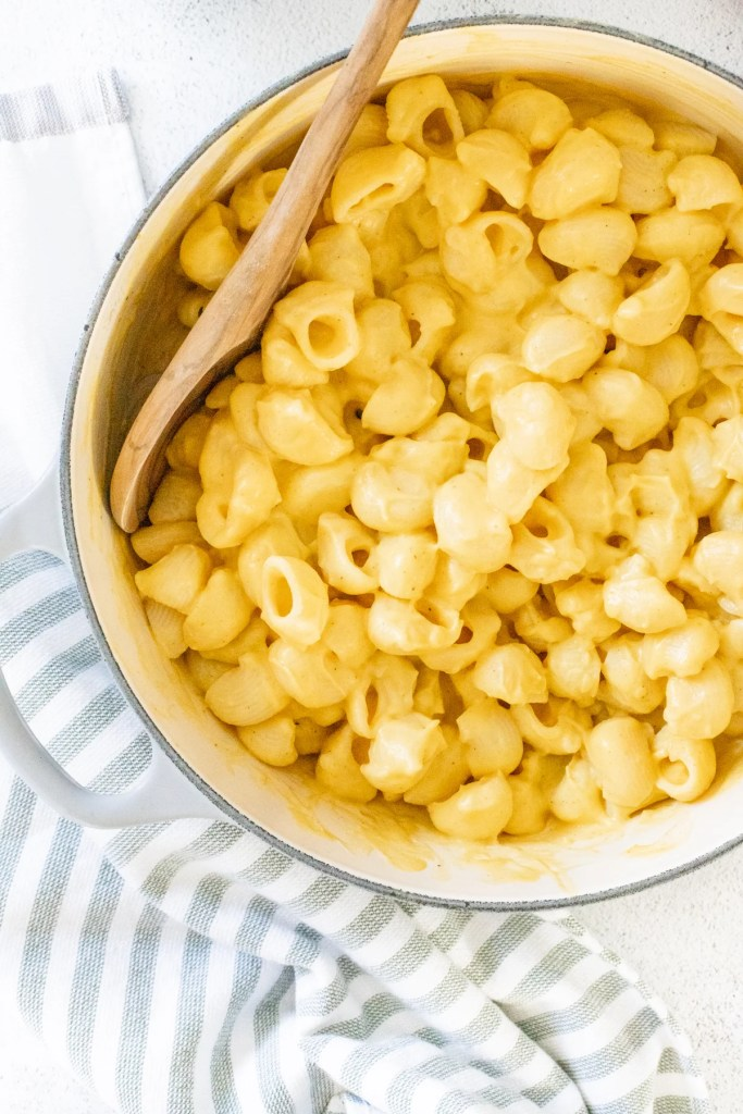 This Vegan Pumpkin Mac and Cheese is creamy and decadent - made with a pumpkin cauliflower sauce that is healthy & delicious. Nut-free. Potato-free. Carrot-free | ThisSavoryVegan.com #thissavoryvegan #veganmacandcheese #pumpkinmacandcheese