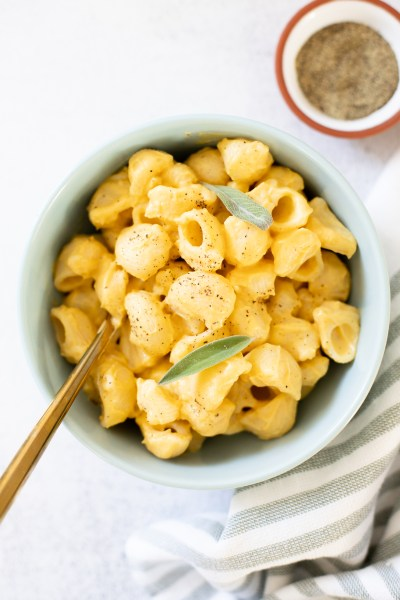 This Vegan Pumpkin Mac and Cheese is creamy and decadent - made with a pumpkin cauliflower sauce that is healthy & delicious. Nut-free. Potato-free. Carrot-free   ThisSavoryVegan.com #thissavoryvegan #veganmacandcheese #pumpkinmacandcheese