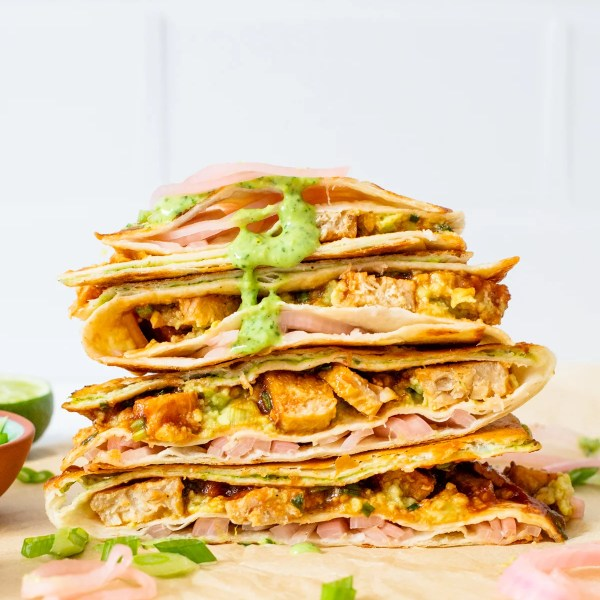This Vegan BBQ Chicken Folded Wrap is inspired by the tiktok trend! A toasty wrap with avocado, pickled onions, a creamy sauce & vegan chicken. All in a compact tortilla you can take on the go | ThisSavoryVegan.com #thissavoryvegan #tiktokwrap #veganwrapideas