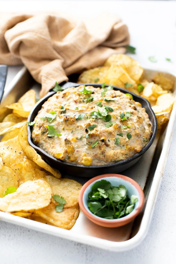 This Vegan Roasted Poblano Corn Dip is the perfect game day snack. Deliciously creamy and slightly spicy - dig in with your fave chips | ThisSavoryVegan.com #thissavoryvegan #vegangamedaysnacks #corndip