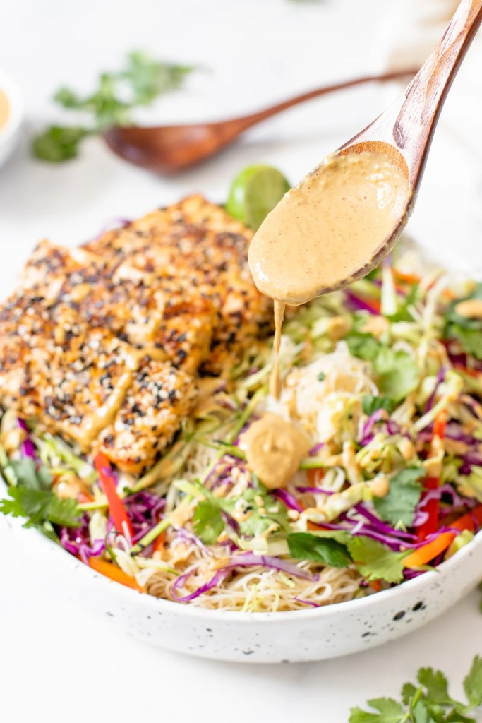 This Peanut Noodle Salad with Sesame Tofu is a combo of crunchy raw veggies, vermicelli rice noodles, crispy sesame tofu and spicy peanut sauce   ThisSavoryVegan.com #thissavoryvegan #peanutnoodles #coldsalads