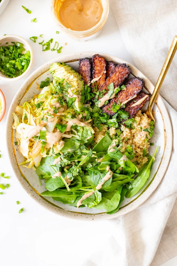 These Hoisin Tempeh Quinoa Bowls are filled with crispy tempeh, wilted cabbage, crunchy spinach, quinoa, avocado & a balsamic tahini dressing   ThisSavoryVegan.com #thissavoryvegan #tempehrecipes #quinoabowls