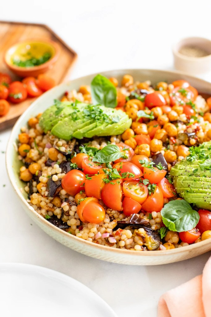 This Roasted Eggplant Couscous Salad is veggie-packed and tossed in a tangy red wine vinegar dressing. Top it off with fresh herbs & avocado | ThisSavoryVegan.com #thissavoryvegan #couscous #vegansalad