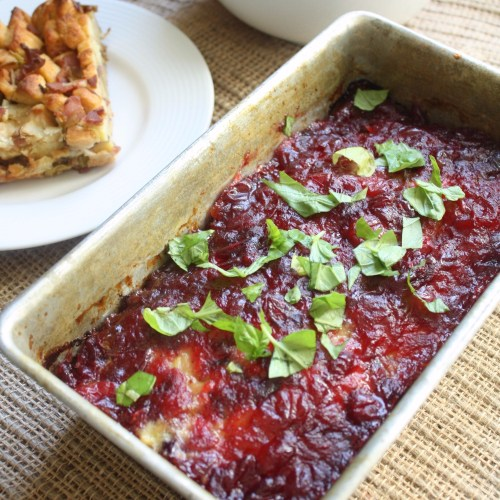 turkey meatloaf in a loaf pan topped with cranberry glaze