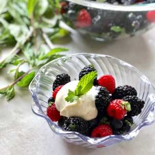 berries in a bowl with creme fraiche on top