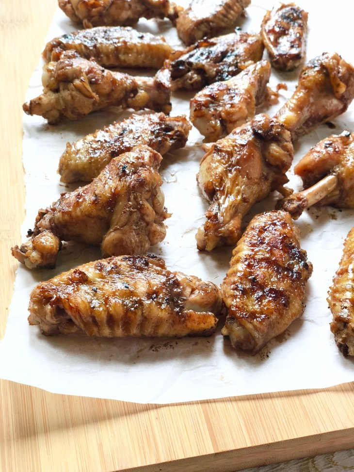 grilled chicken wings on cutting board