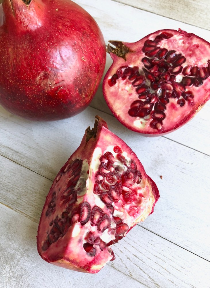 pomegranates on a table