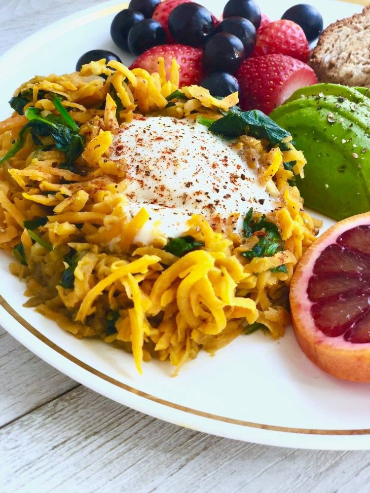 sweet potato hash with fruit on a plate
