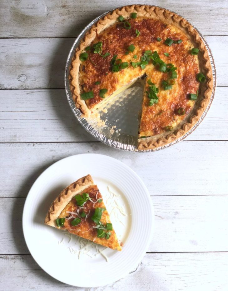 breakfast quiche slice on a plate next to pan