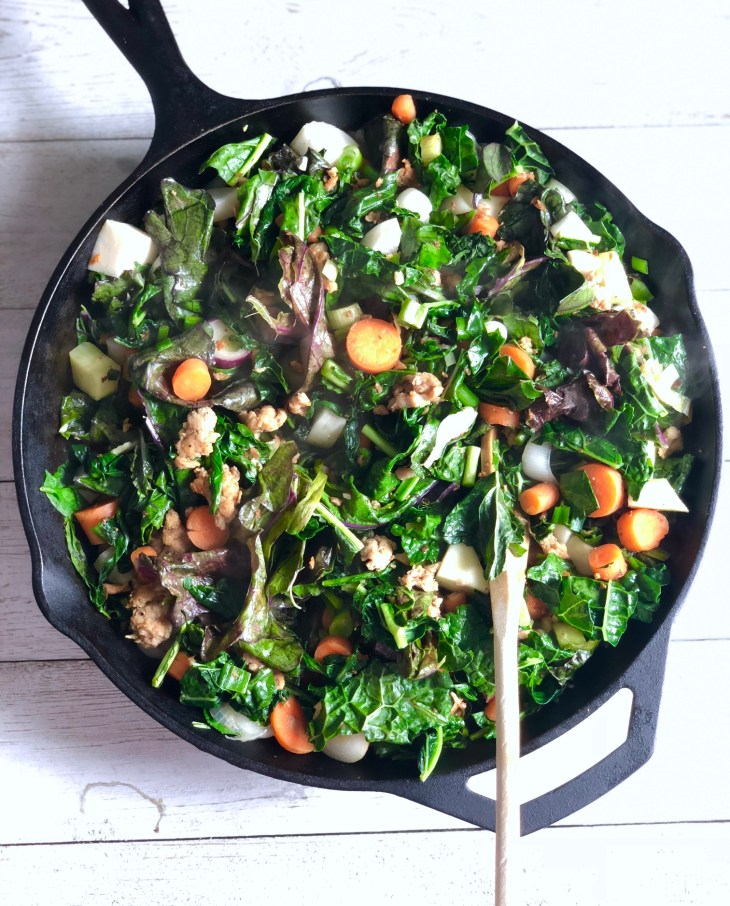 sauteing spring veggies in a cast iron skillet