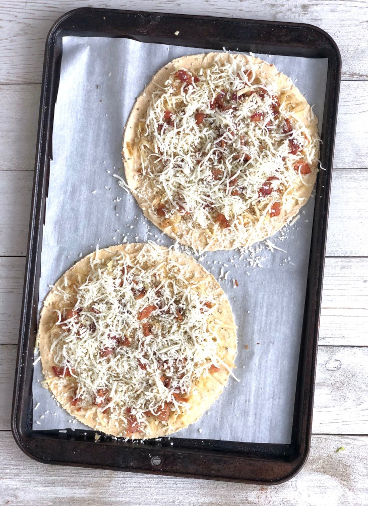 flatbreads on a pan ready to bake