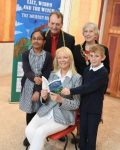 The Mayor and Mayoress of South Tyneside, Cllr Alan Smith and his wife Cllr Moira Smith, at the Lily, Windy and the Witch book launch with Rabiah Zinat and Alfie James from Hadrian Primary school either side of the author Yvonne Carlin-Page