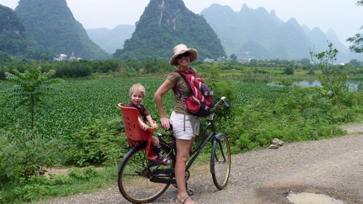 Clare on a tandem cycling along the river near Yangshuo, China