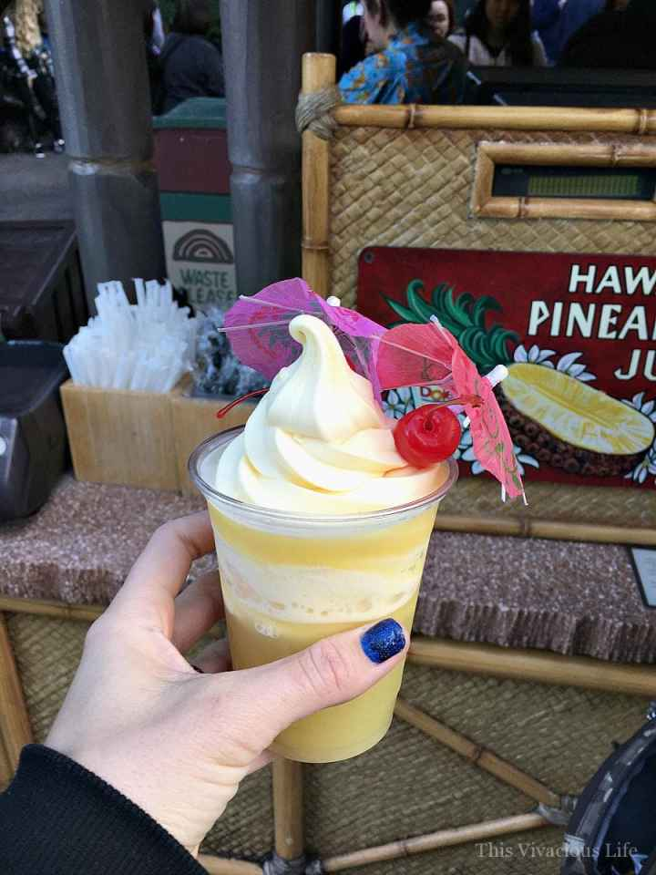 Disneyland Dole whip in a cup with a cherry and umbrella