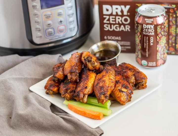 Instant pot chicken wings! They are super sticky thanks to the delicious cola sauce. Honestly, these were some of the best wings I have ever eaten! These are an easy appetizer that everyone will love. #AD @drysoda