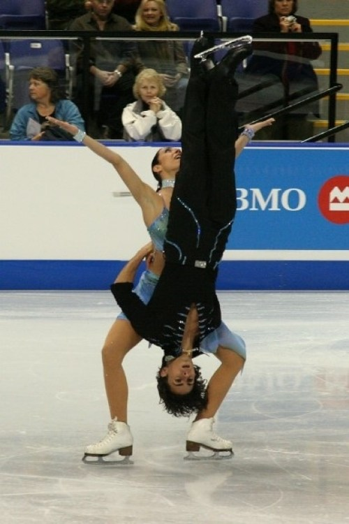 These ice skaters. How, exactly, is he holding on?