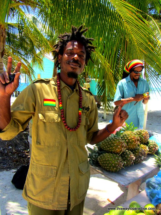 Rasta guy in Caye Caulker selling cashew fruit