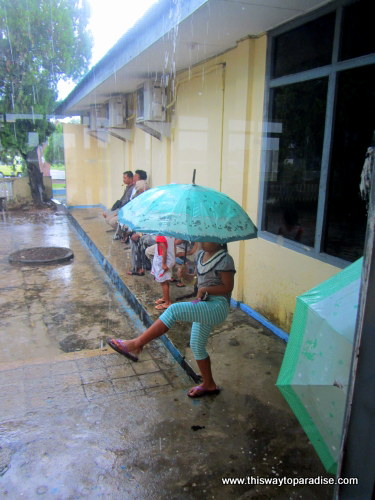 Girl playing in the rain at the Kei Islands (LUV airport) Tual