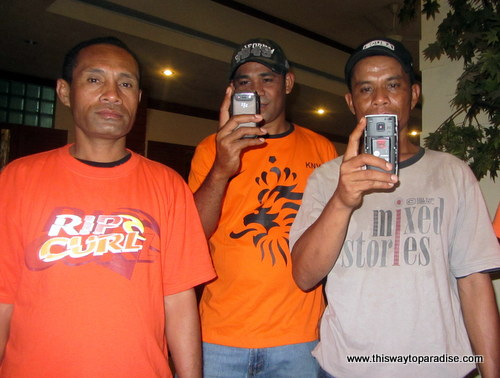 Guys with cameras in Maluku, Indonesia
