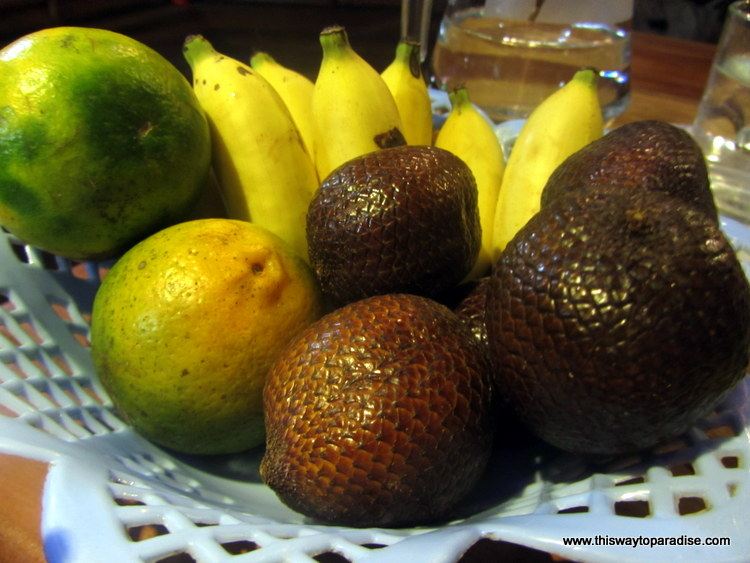 Snake fruit, bananas, and oranges